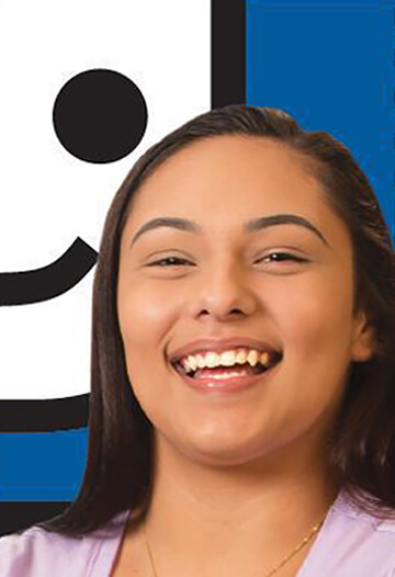 Ashley smiling in front of the Goodwill logo