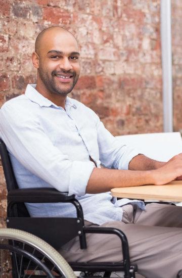 man in wheelchair typing