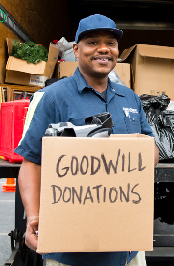 Goodwill volunteer accepting a donation