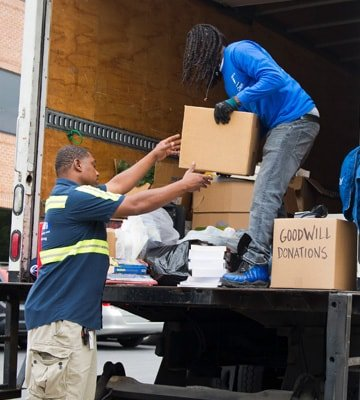 Workers collecting Goodwill Donations