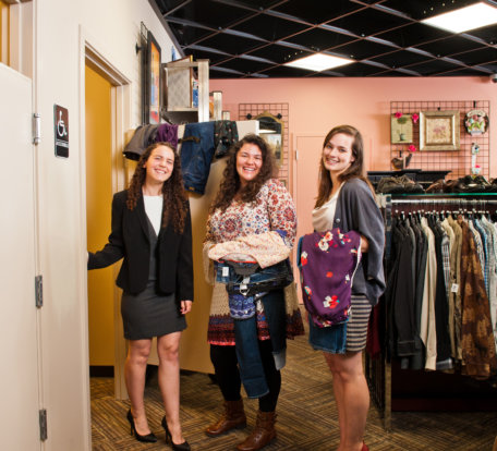Three women shopping at a Goodwill boutique