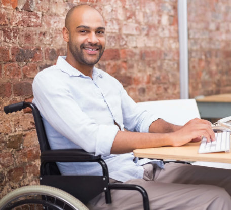 man in wheelchair typing