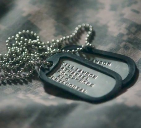 Goodwill helps returning veterans find jobs. (Image of military dog tags laying on camouflage)